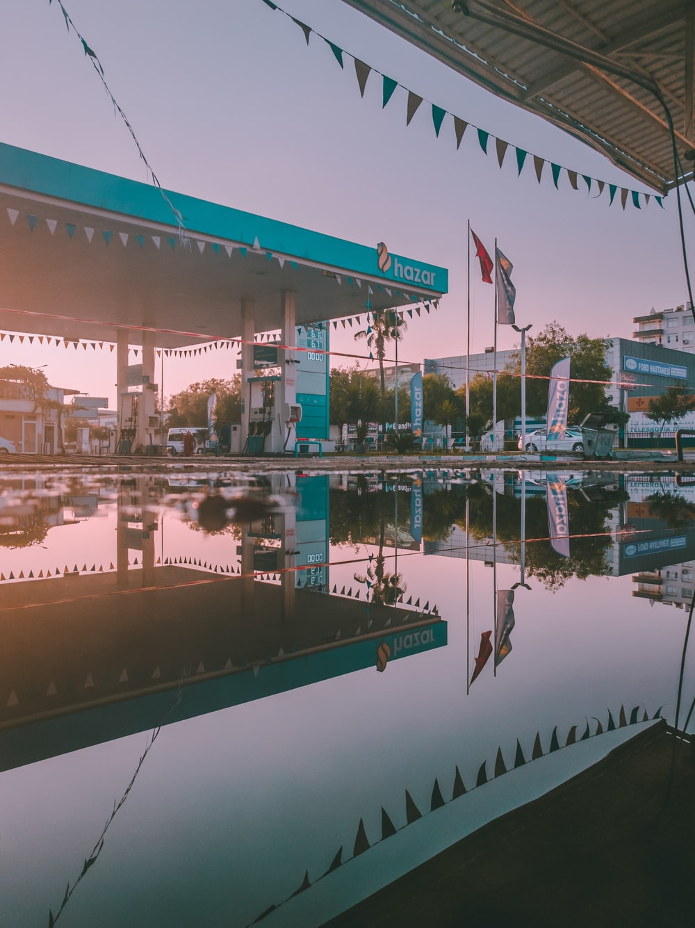 teal Hazar gasoline station under gray sky