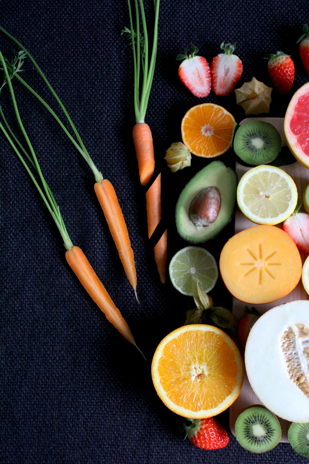 sliced vegetable and fruits on board