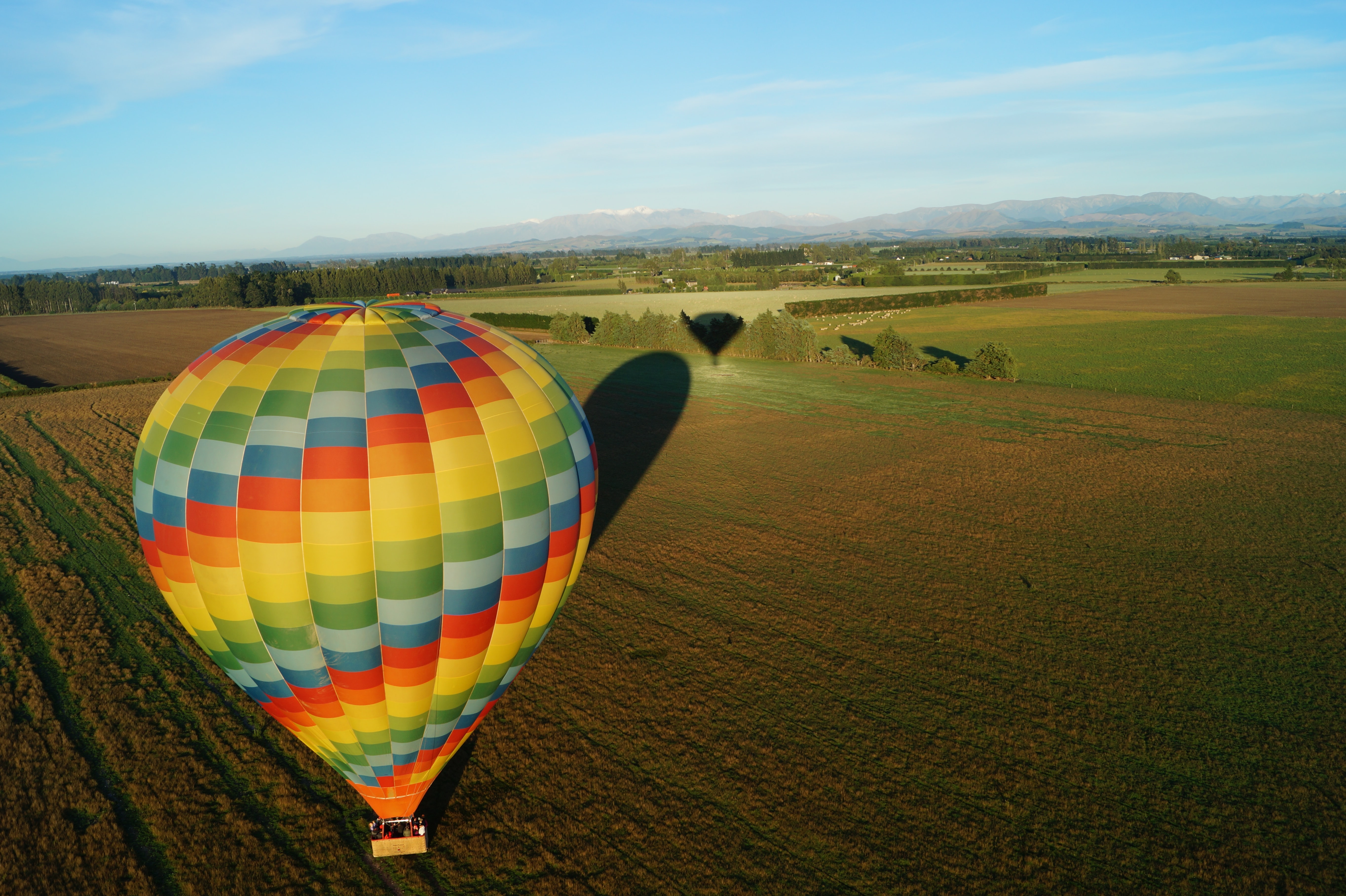 yellow and green hot air balloon during daytime