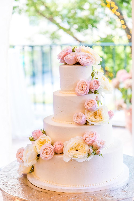 4-layered fondant cake on table