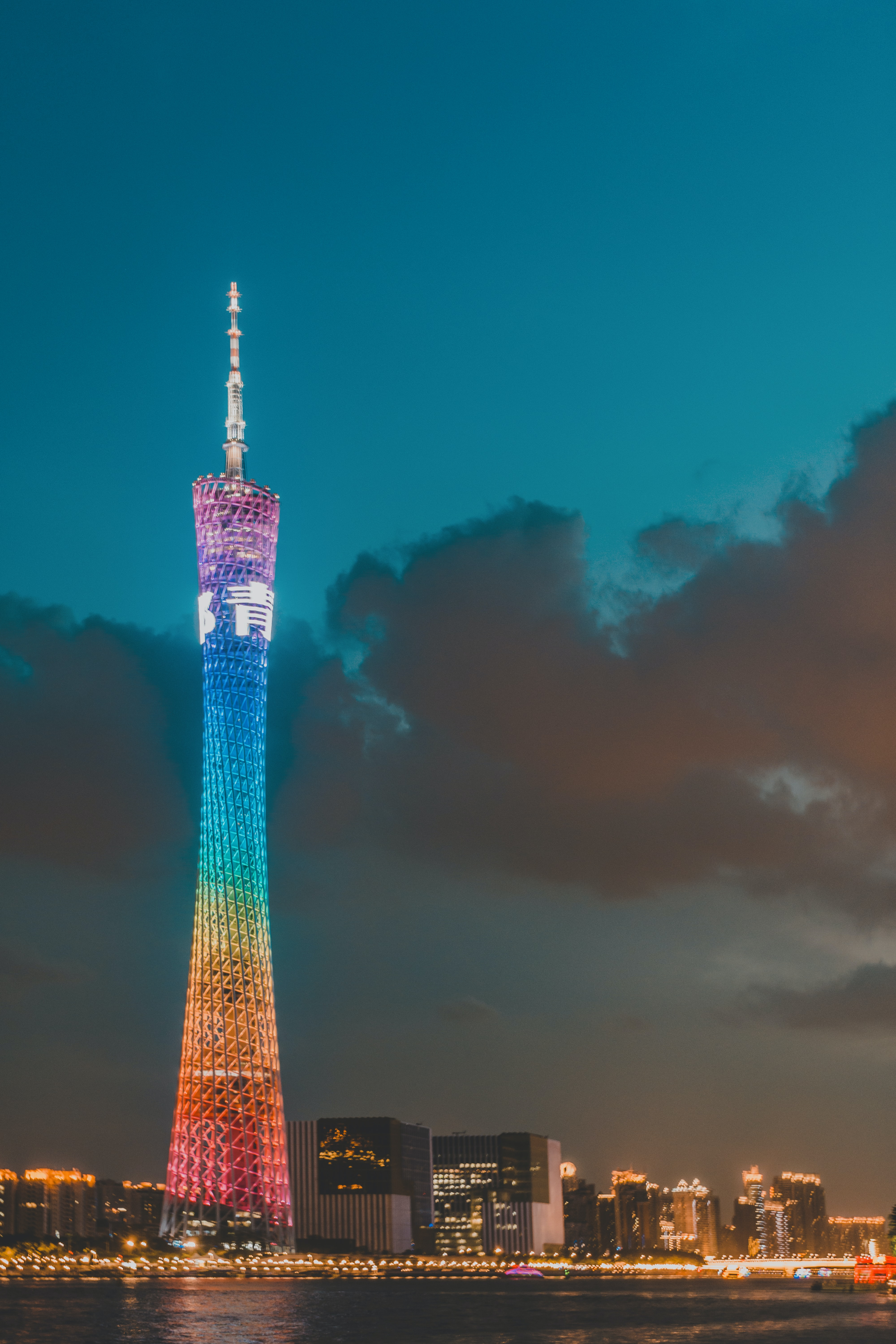 lighted high-rise tower at golden hour