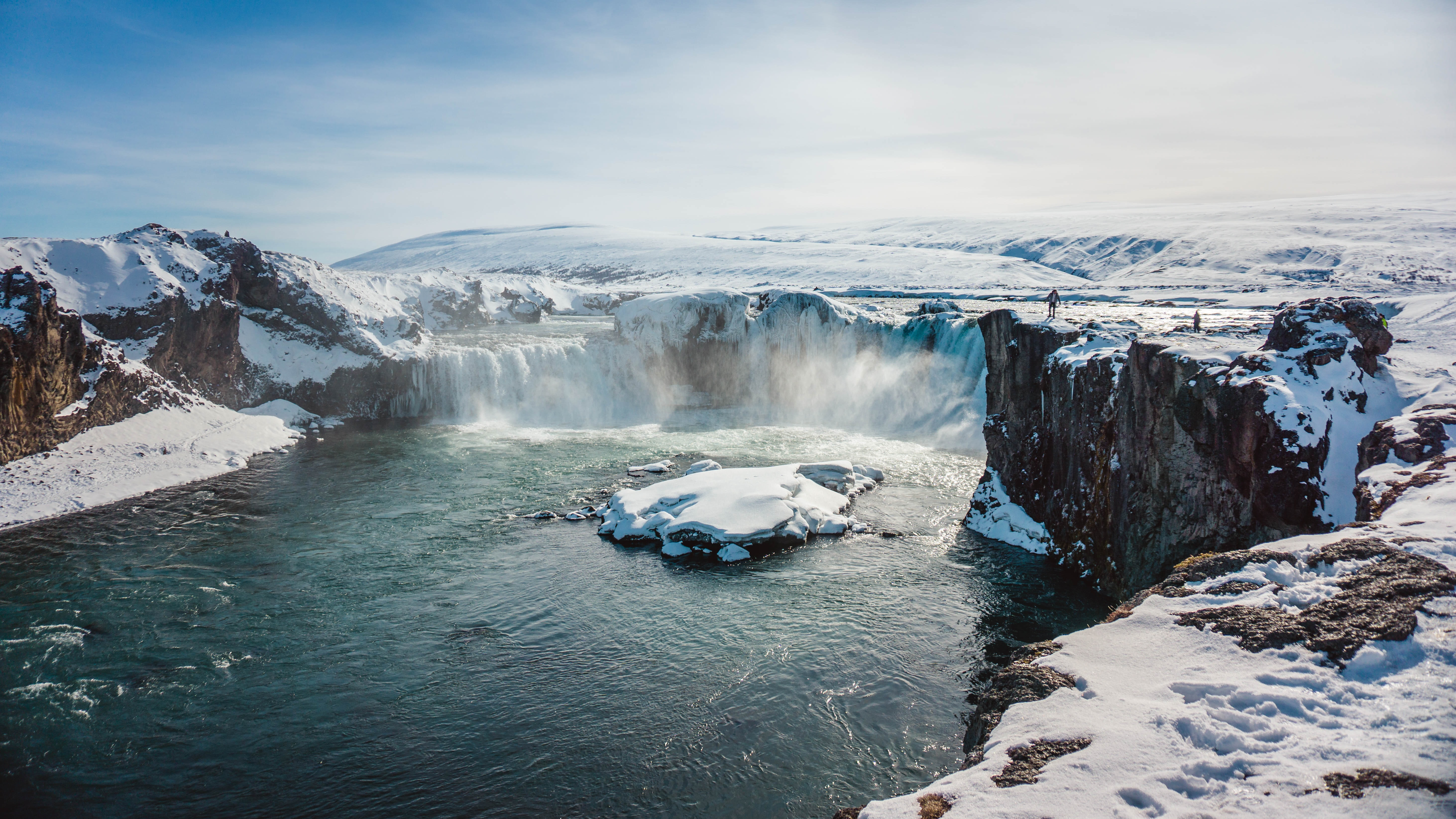 waterfall covered with snow at daytime