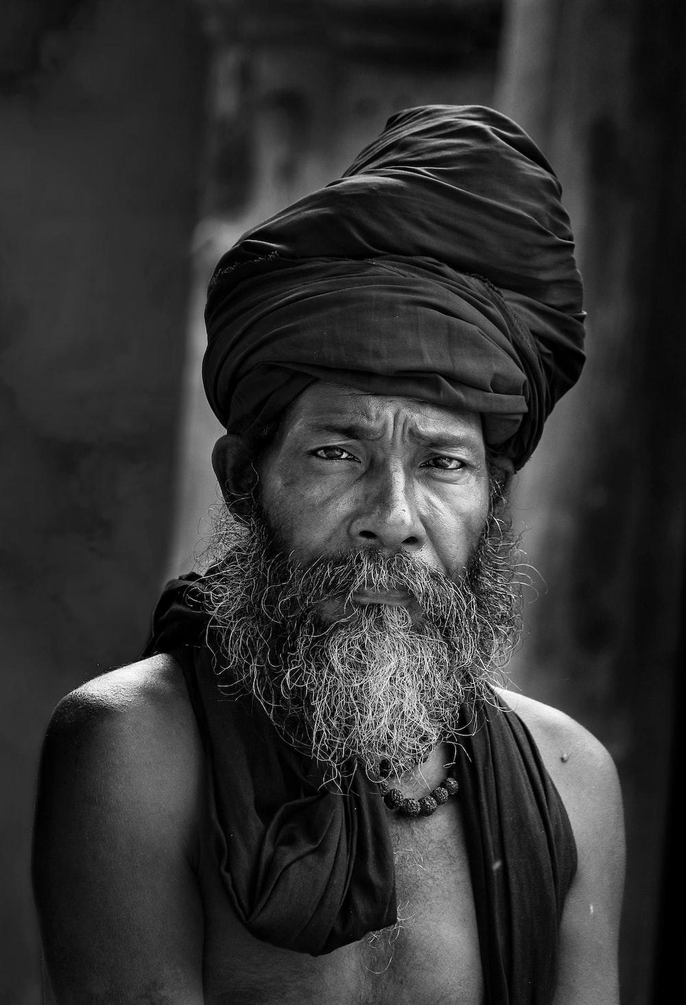 man wearing black turban hat