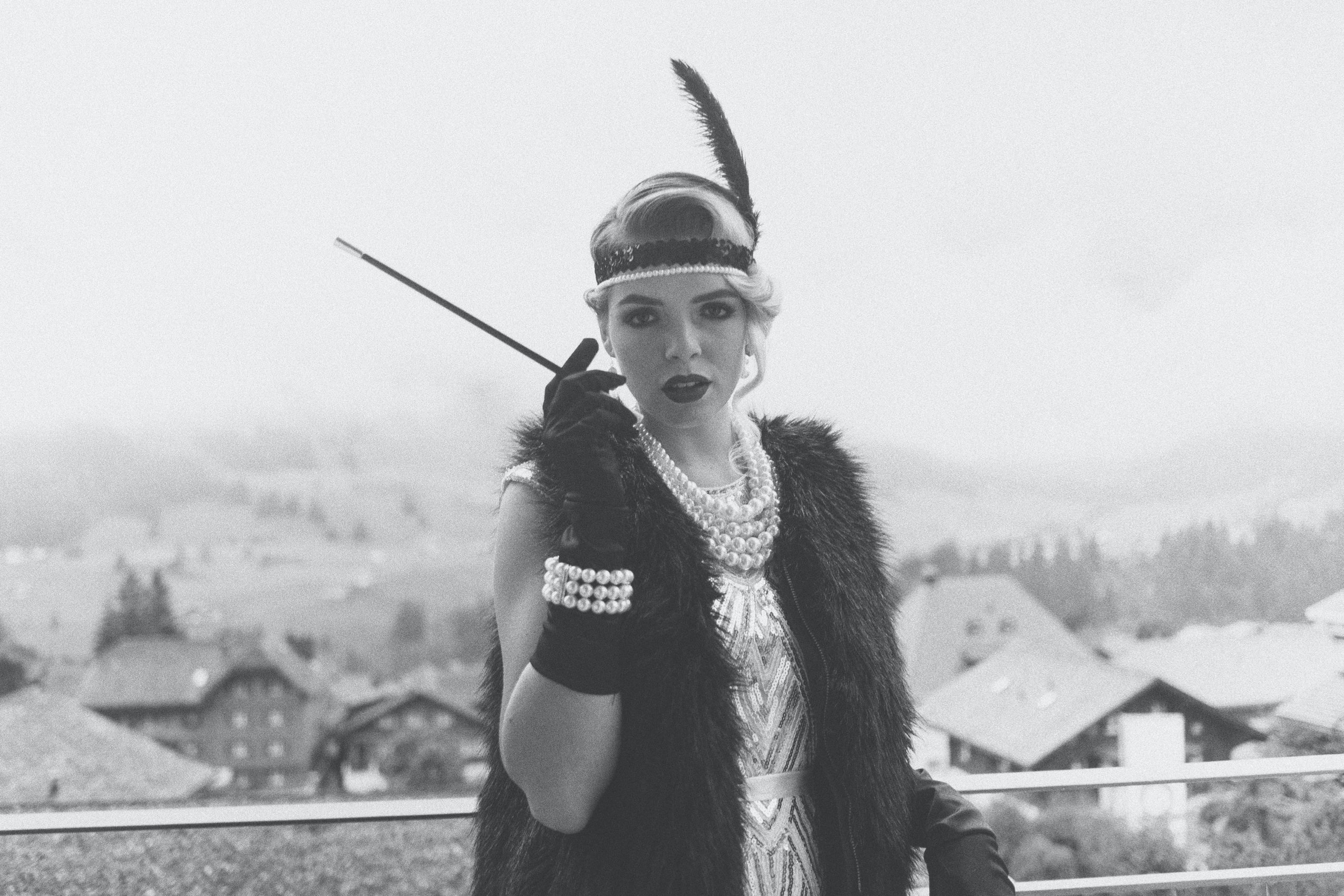 Woman in 20's outfit smoking a cigarette by Marvin Meyer