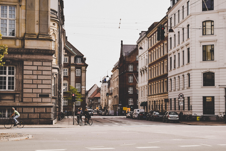 man cycling through street