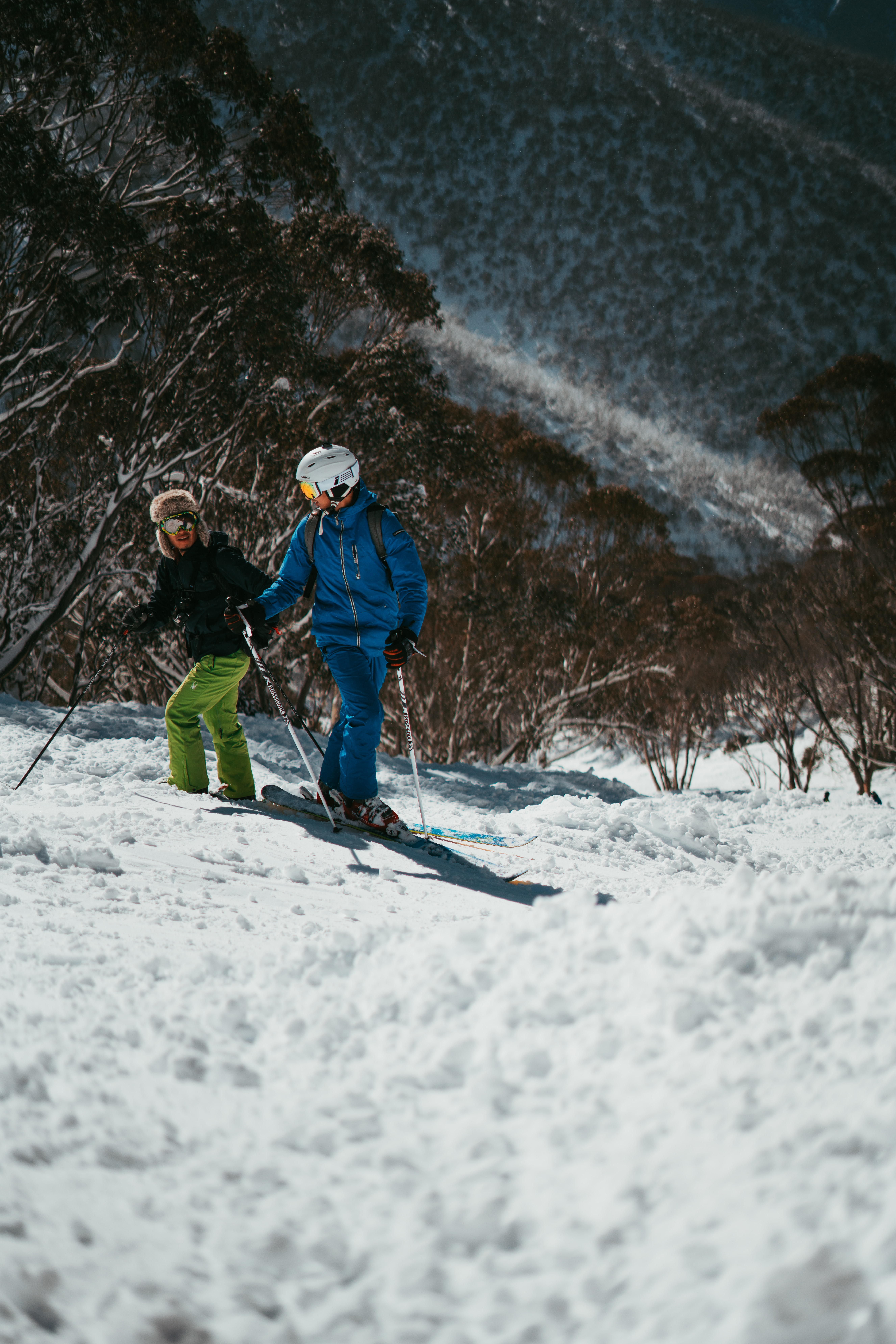 two people skiing on snow mountain
