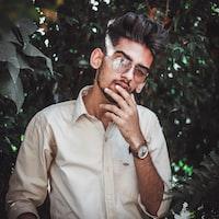 selective focus photography of man wearing brown dress shirt