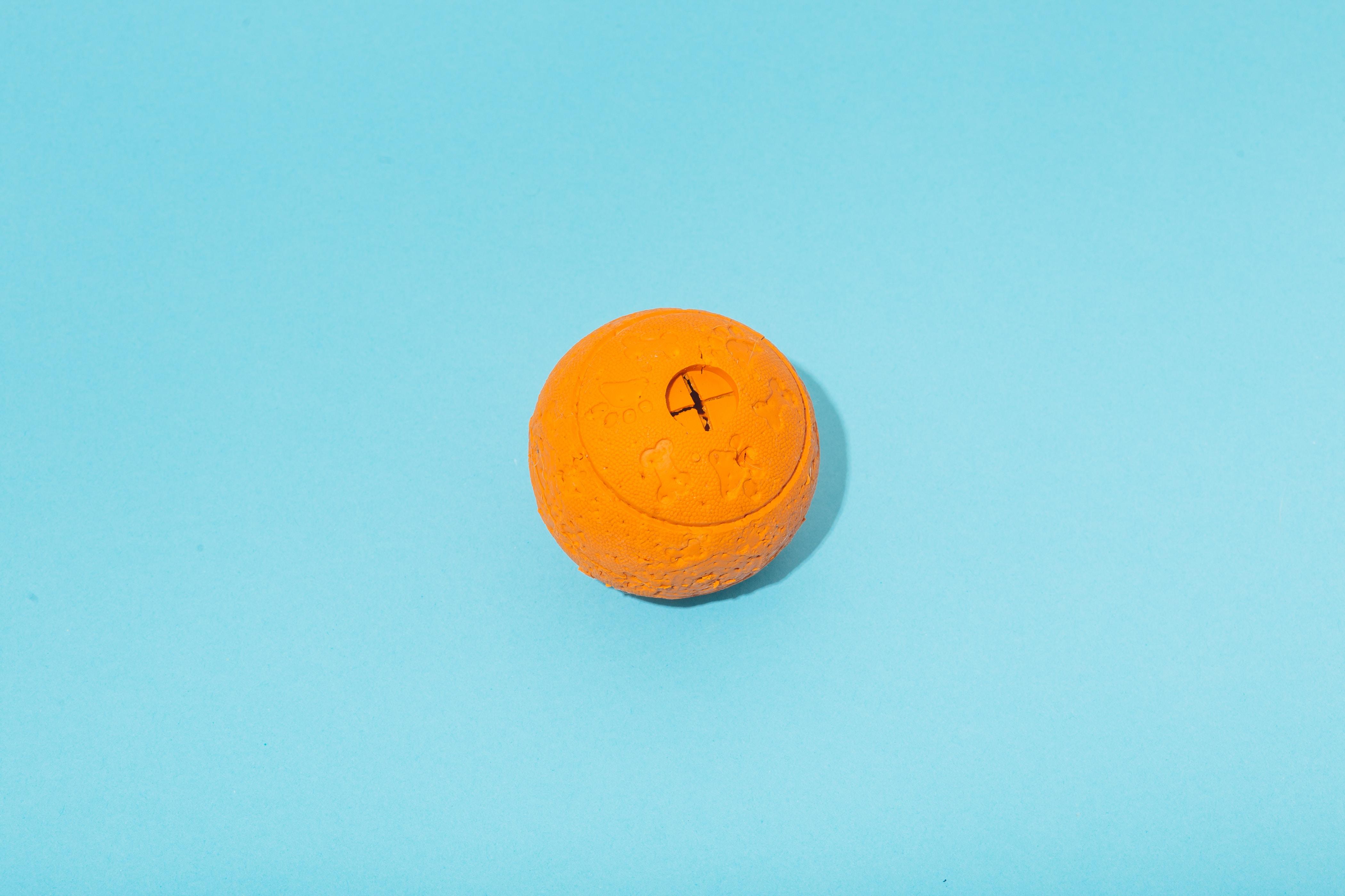 round orange plastic container