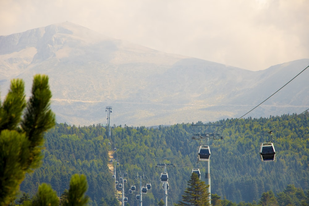 black cable carts on mountain at daytime