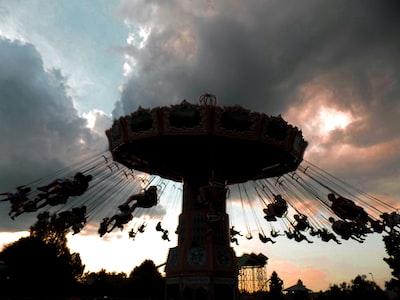 beige carousel under cumulud clouds rosa parks teams background