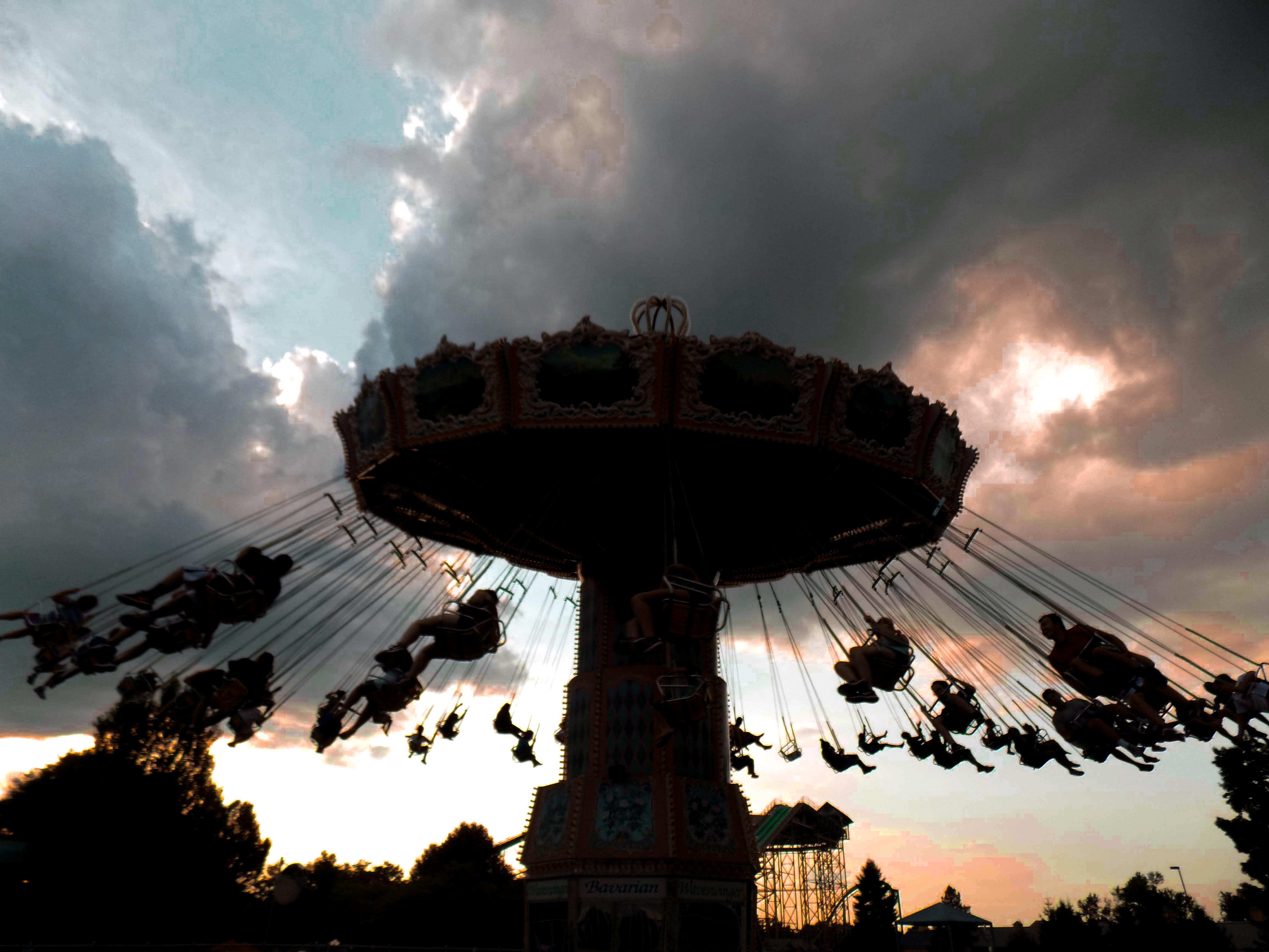 beige carousel under cumulud clouds