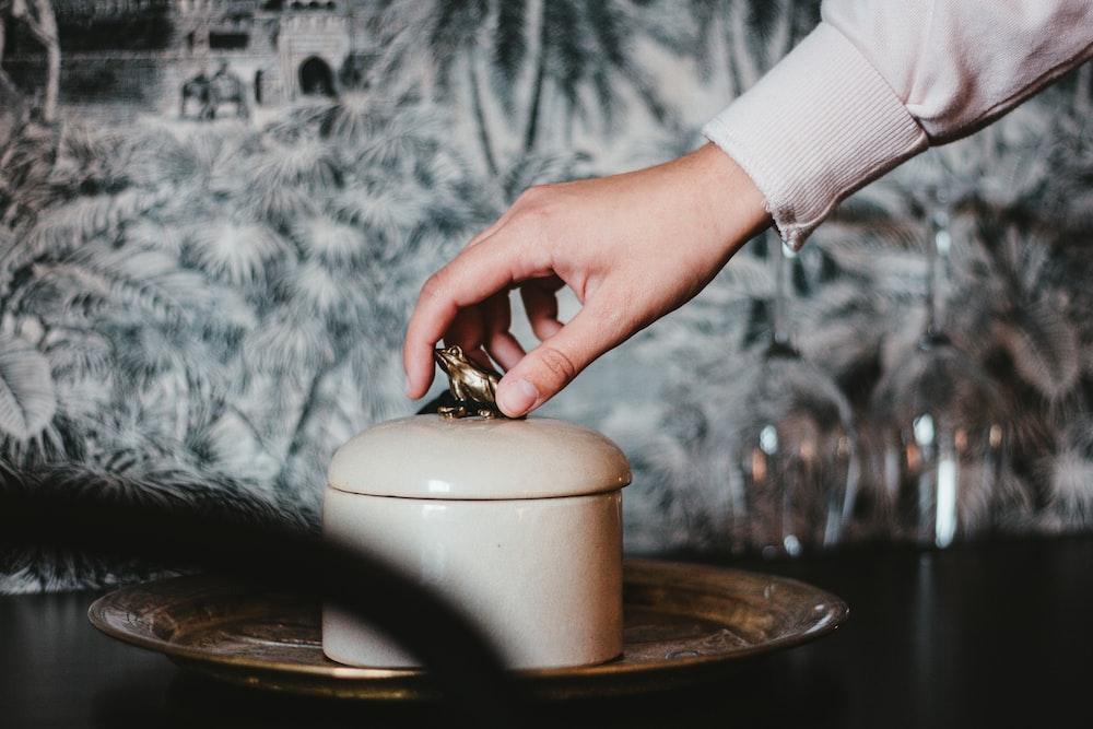 white ceramic jar with lid