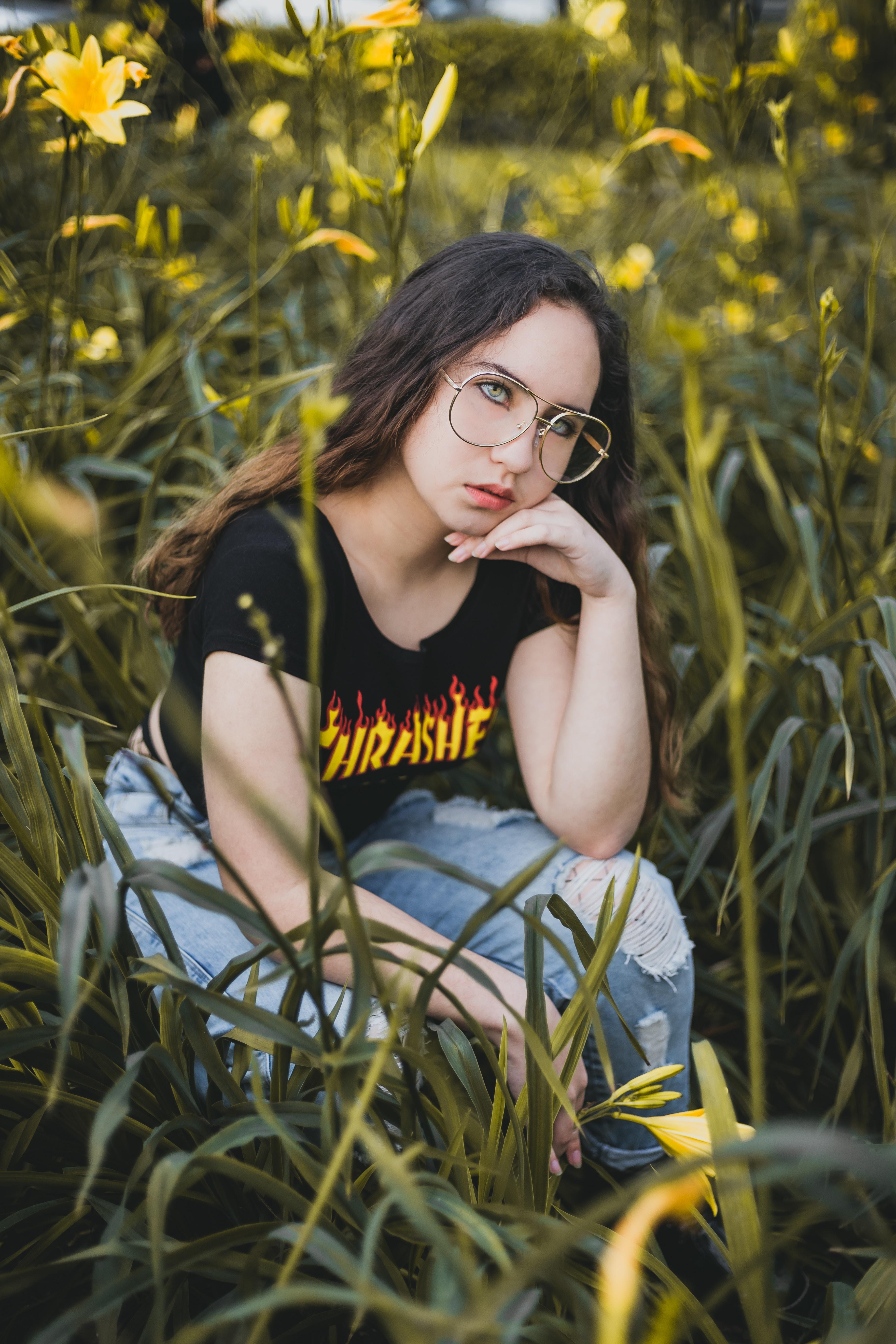 woman sitting on flower garden