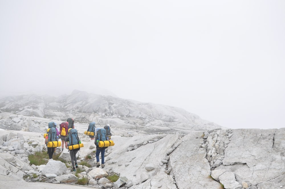 group of people hiking on moutain