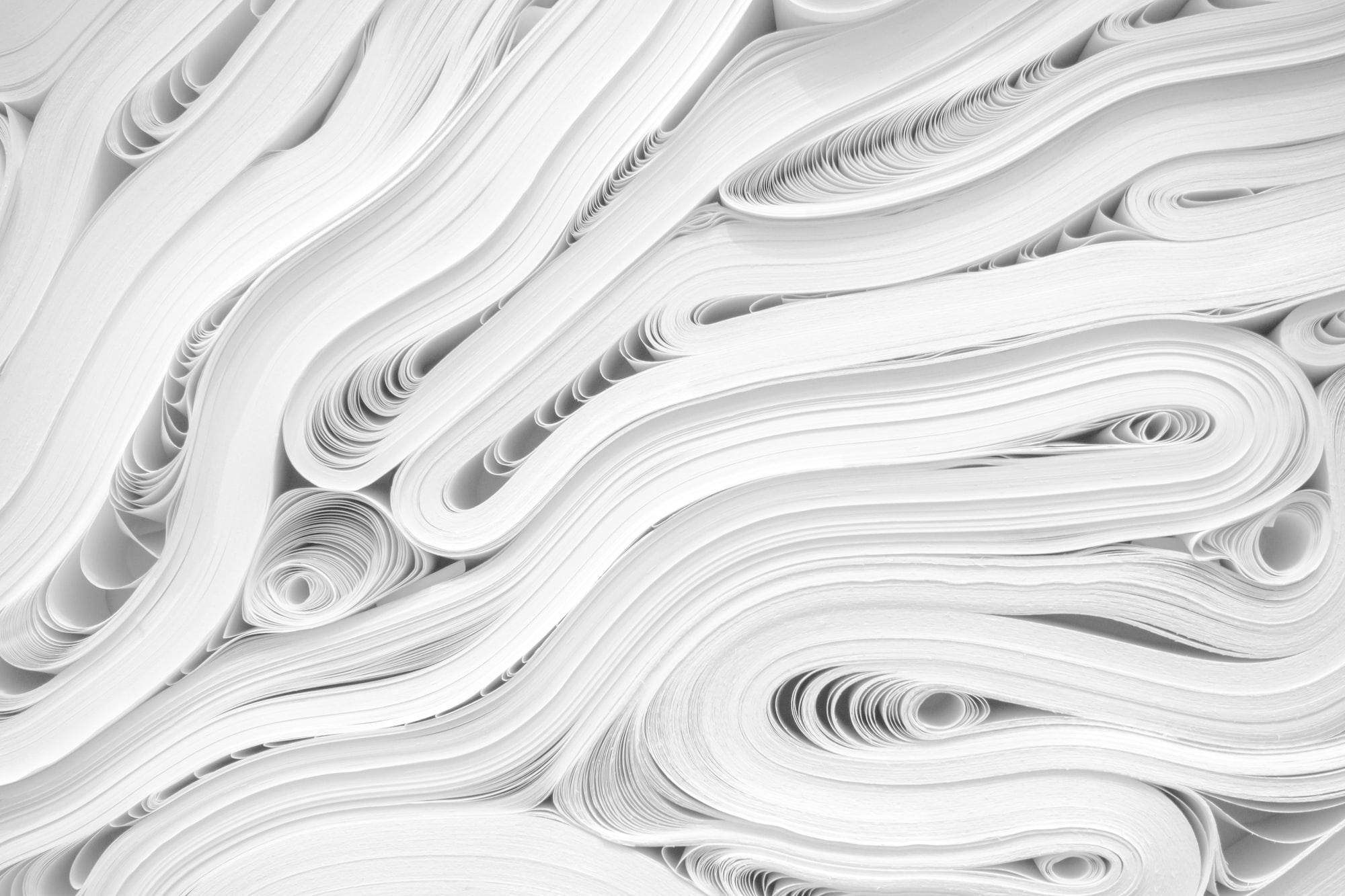 Reams of white paper in swirls.