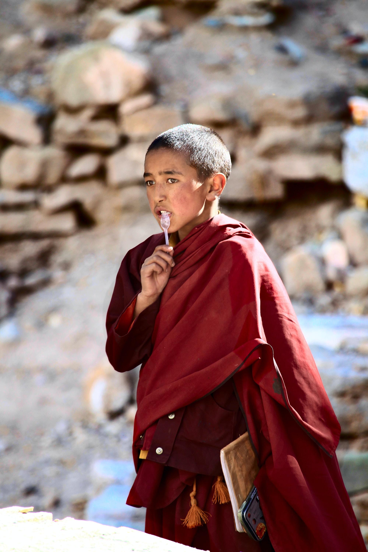 boy wearing maroon coat