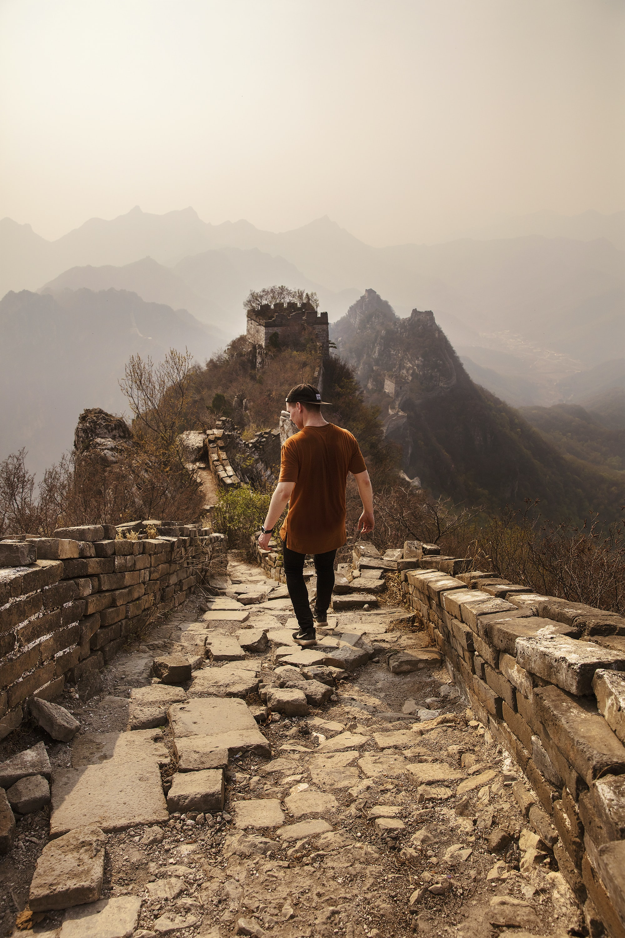 man walking on Great Wall of China