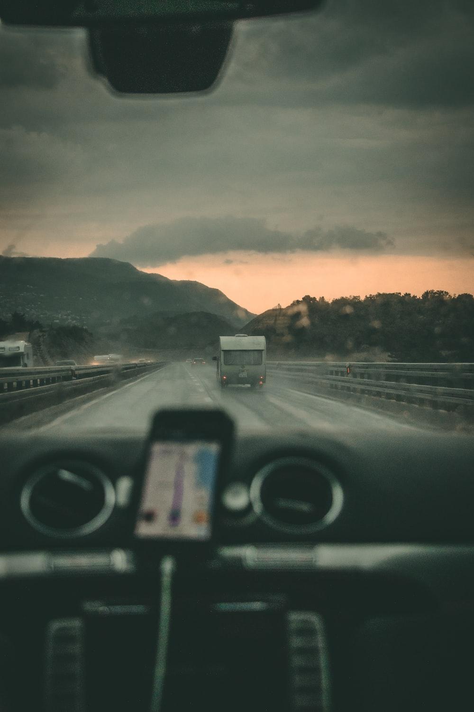 person riding car near mountain range