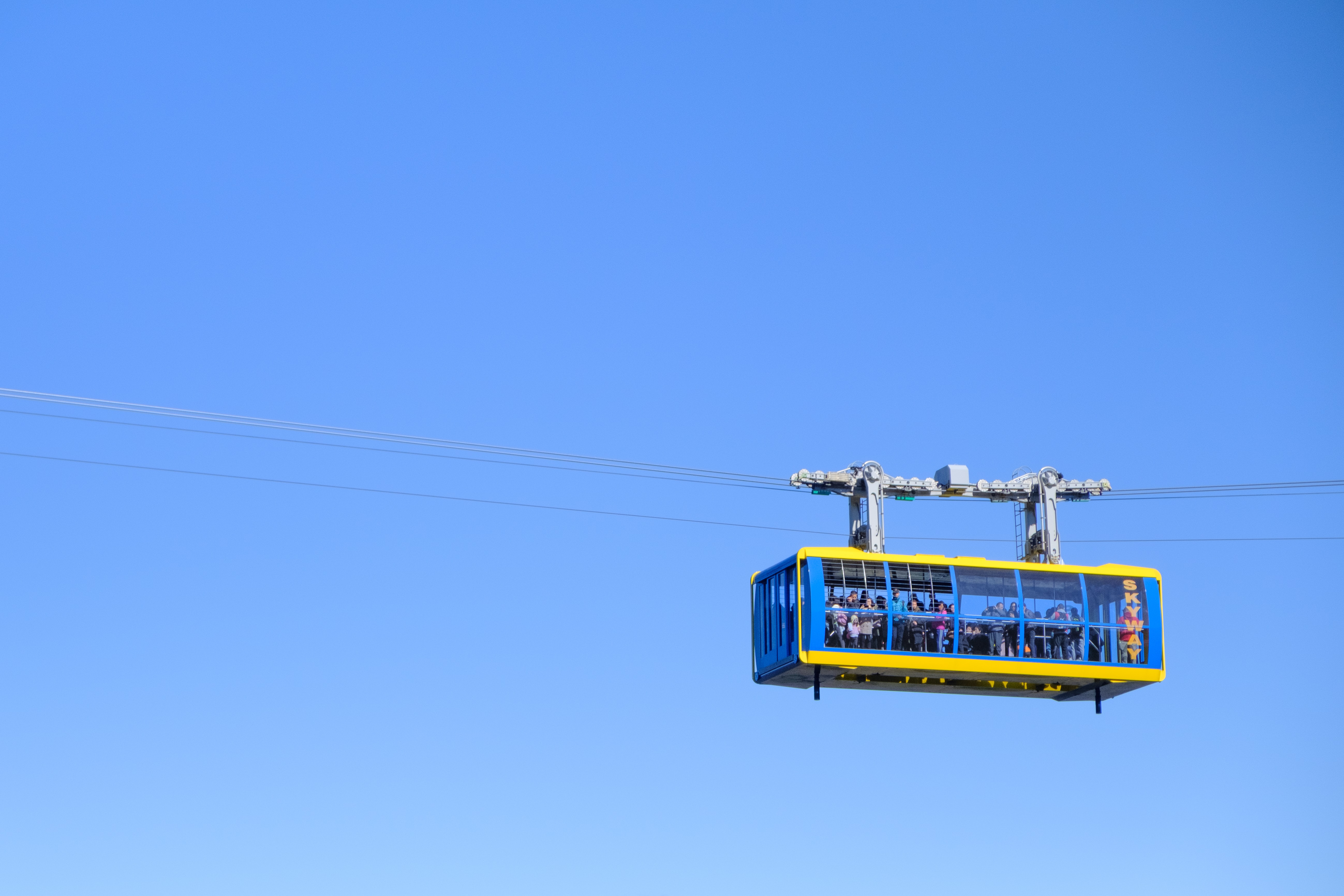 yellow and black cable car under blue sky during daytime