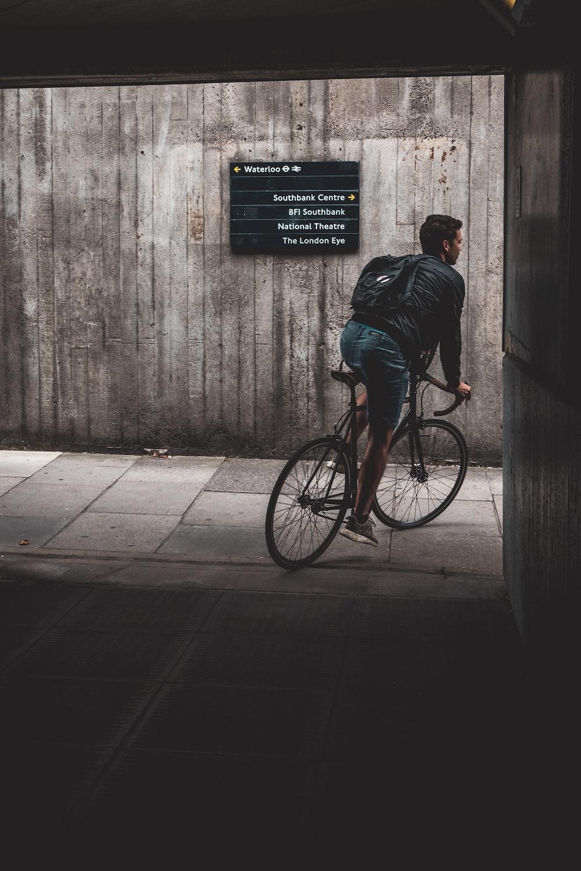 man cycling outdoors