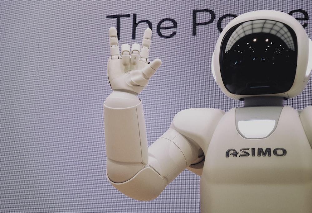 Asimo robot doing handsign