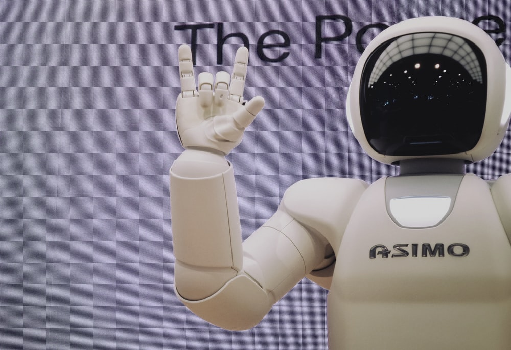 Asimo robot doing handsign