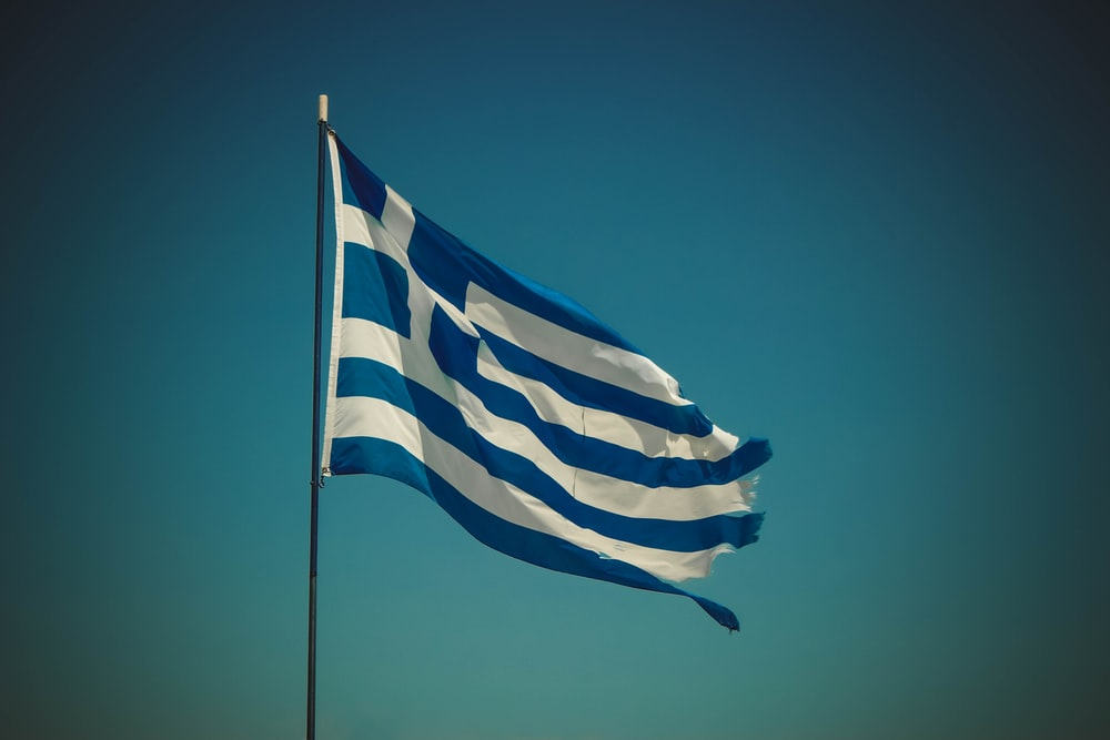 blue and white striped flag placed on pole