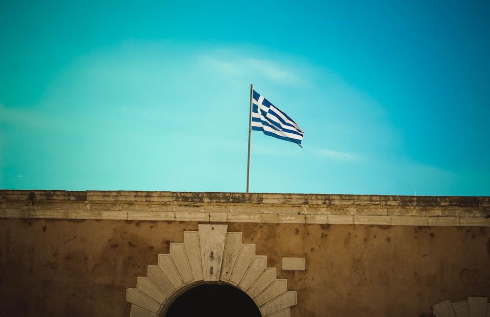flag of Greece hoisted on pole