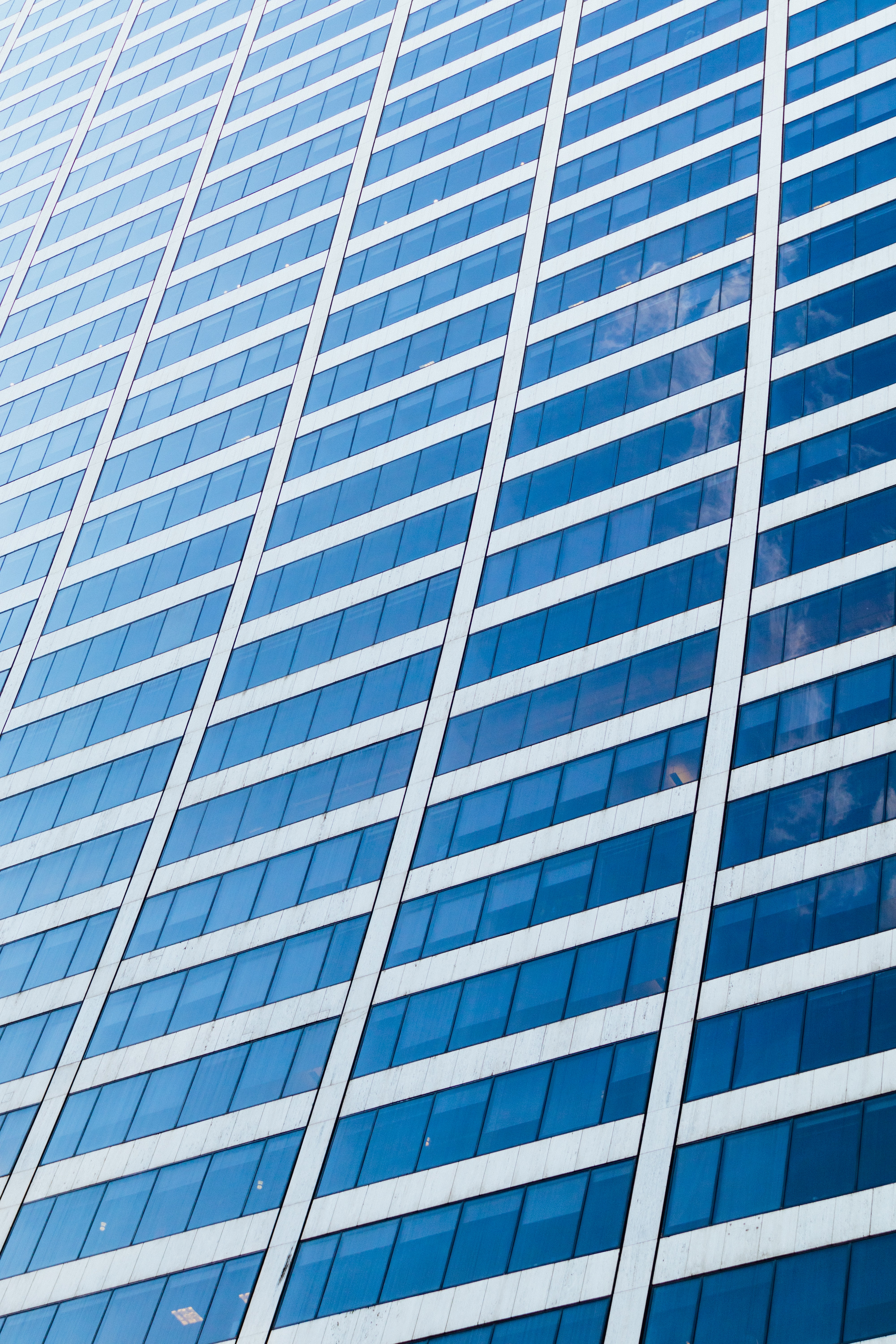 blue and white glass building during daytime