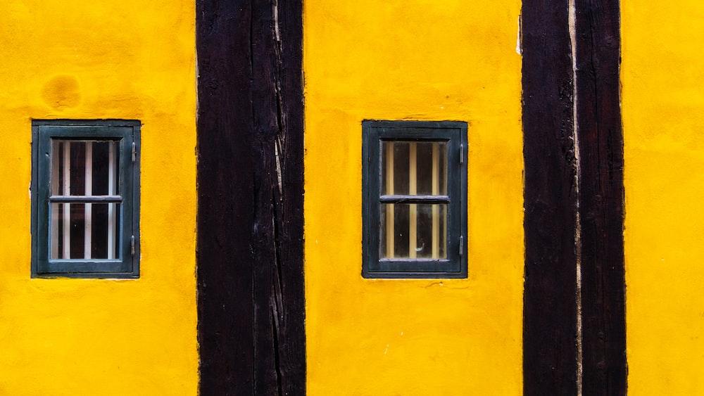 minimalist photography of black and yellow striped windows