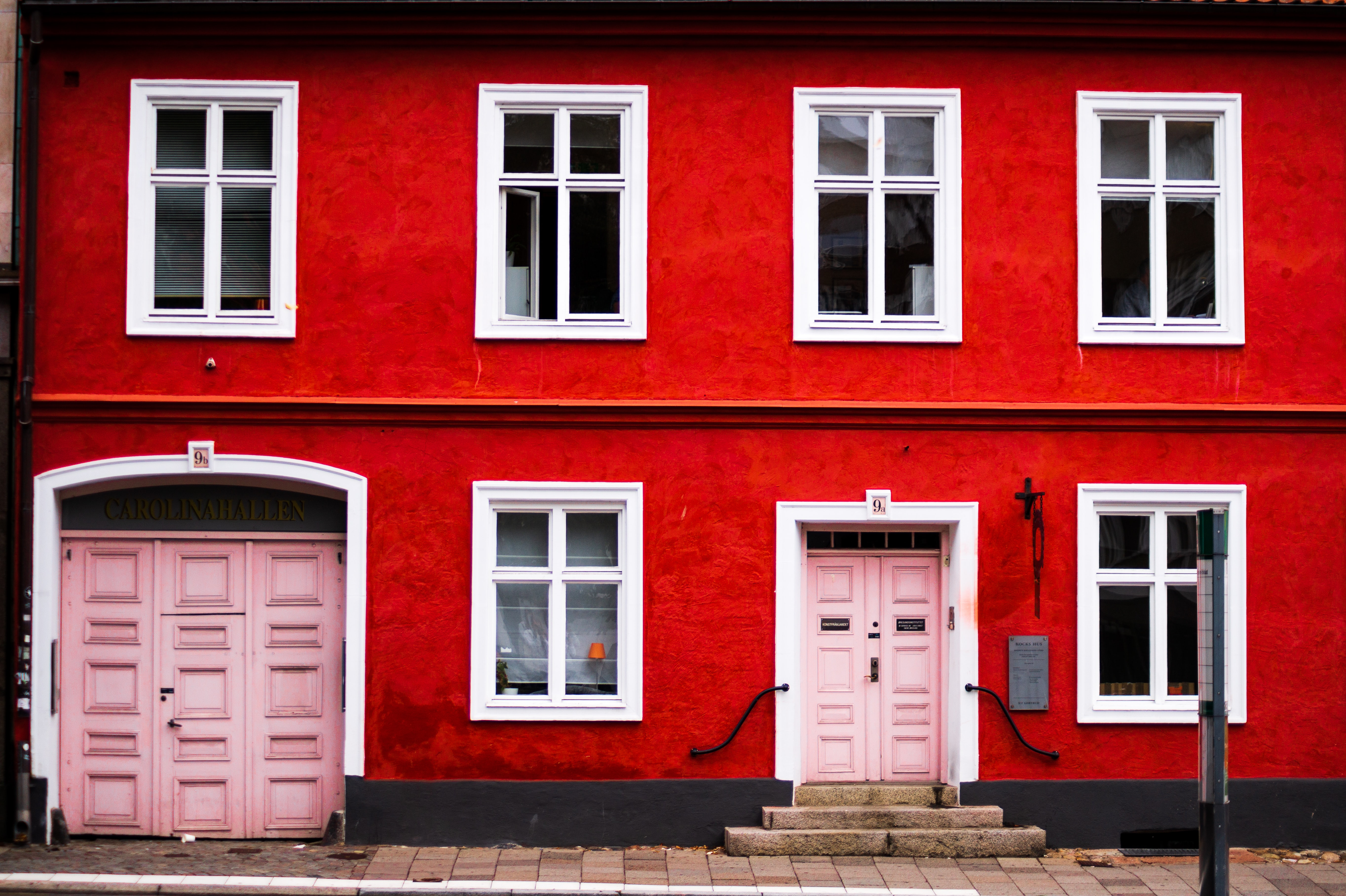 pink wooden double doors are closed