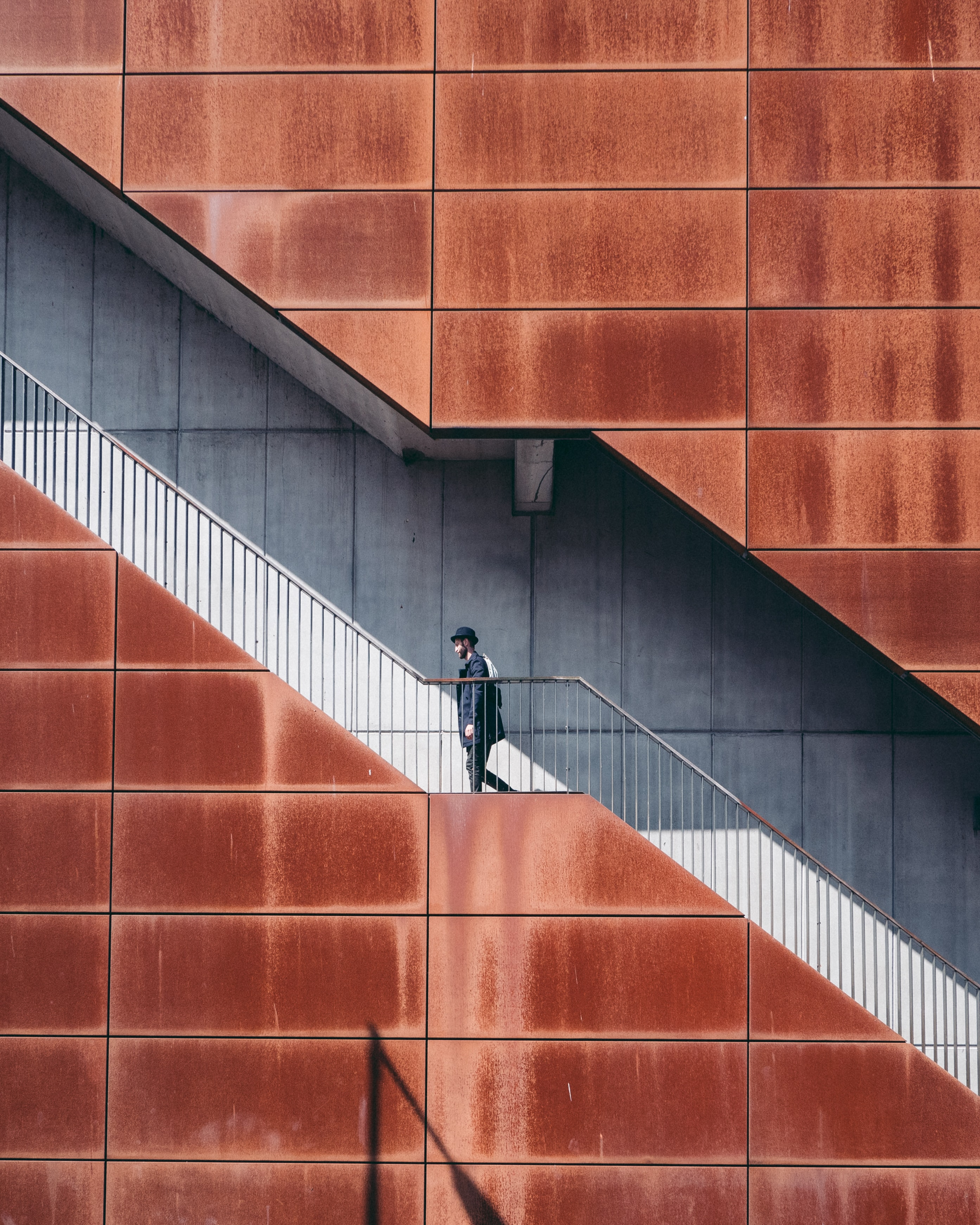 man walking on stairs at daytime