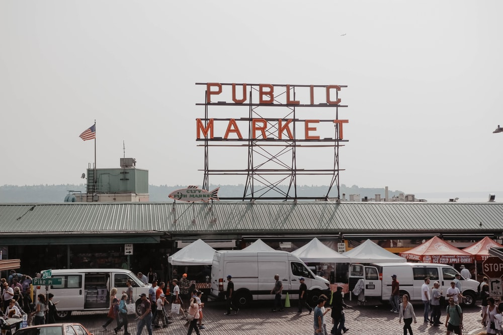 people walking in front of Public Market during daytime