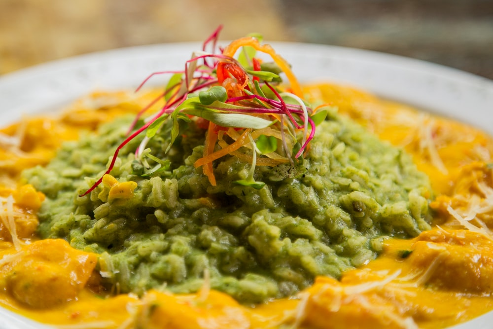 meat with yellow and green sauce