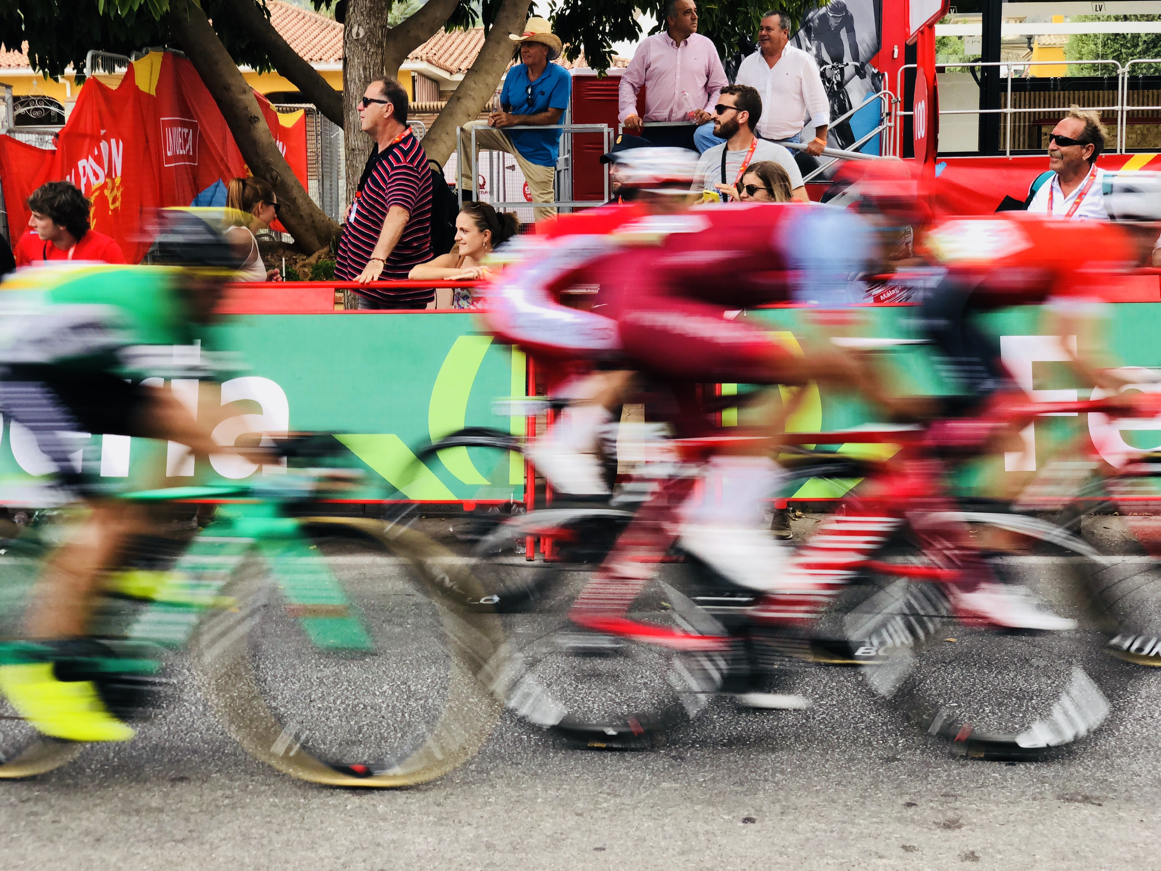 time lapse photography of bikers in marathon