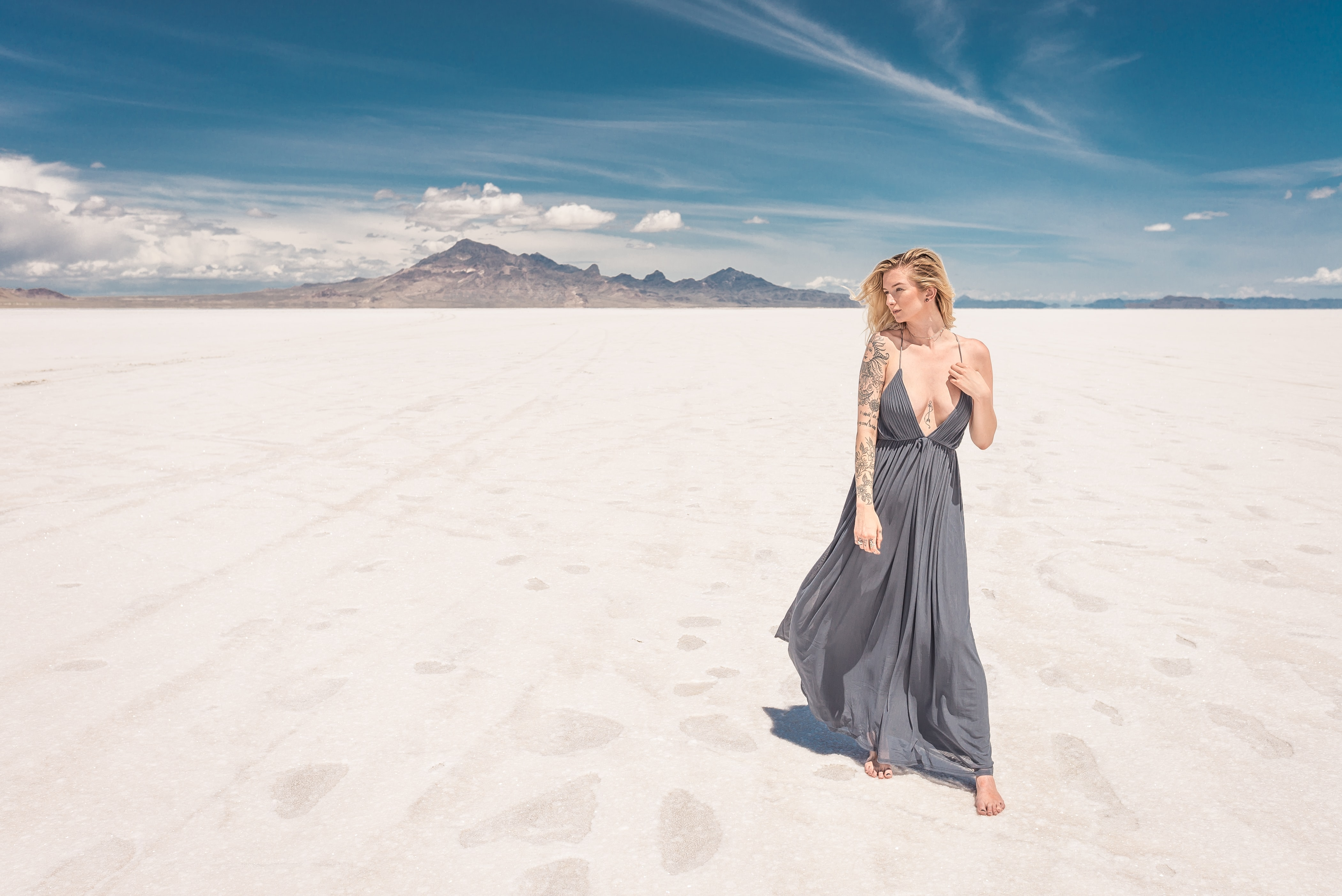woman standing on white sands