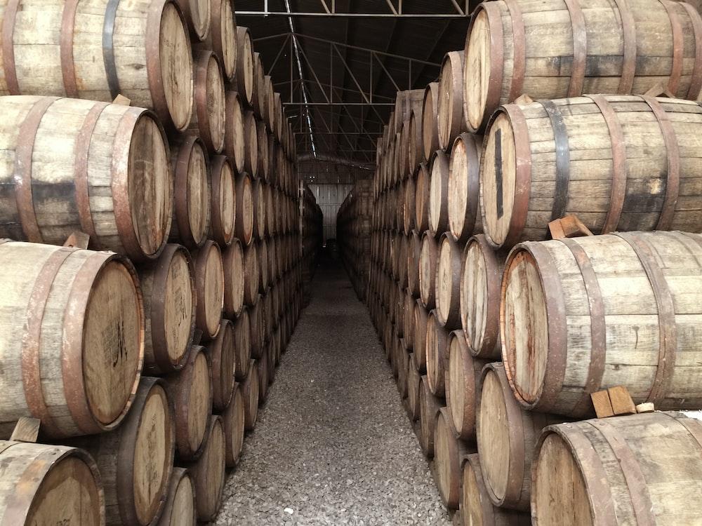 pile brown barrels inside building