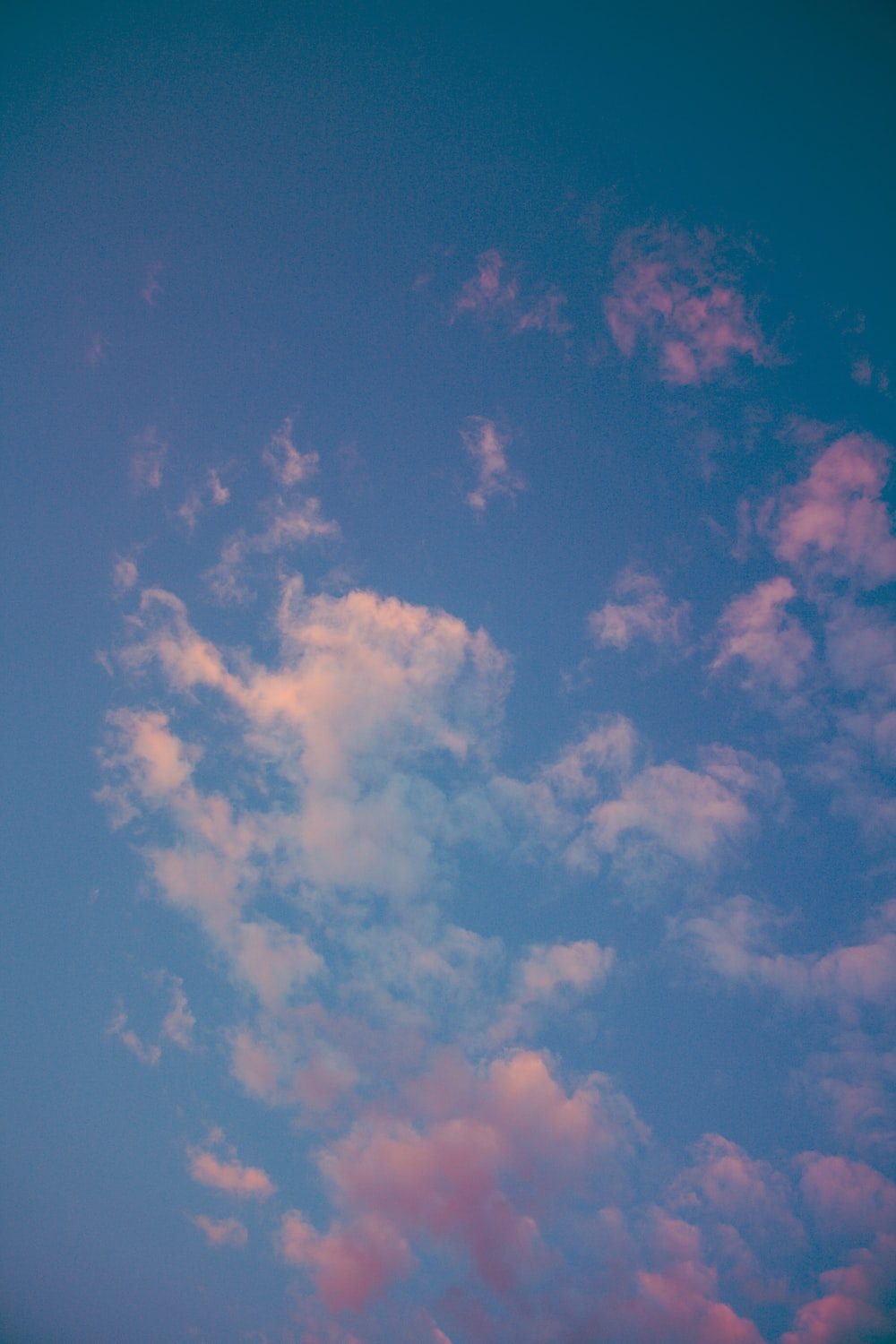 low angle photo of blue sky and white clouds