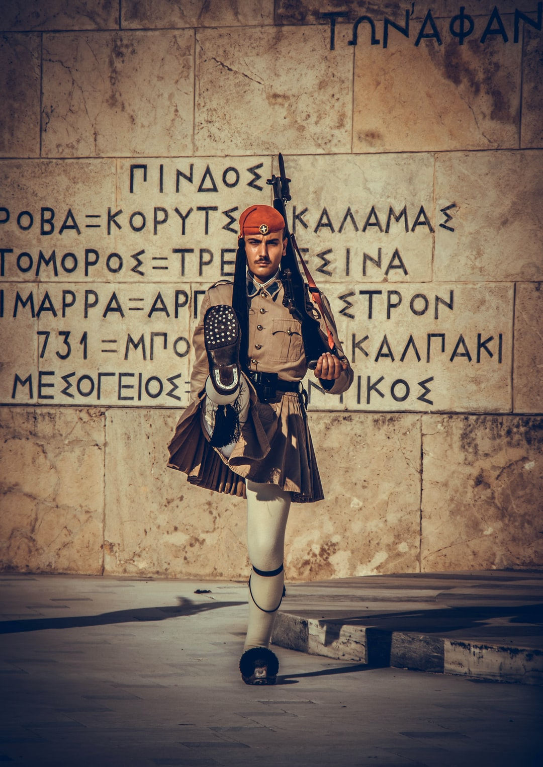 The Evzones or Evzonoi, is the name of several historical elite light infantry and mountain units of the Greek Army. Today, it refers to the members of the Presidential Guard, a ceremonial unit that guards the Greek Tomb of the Unknown Soldier and the Presidential Mansion in Athens.