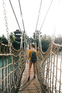 woman standing on rope made bridge