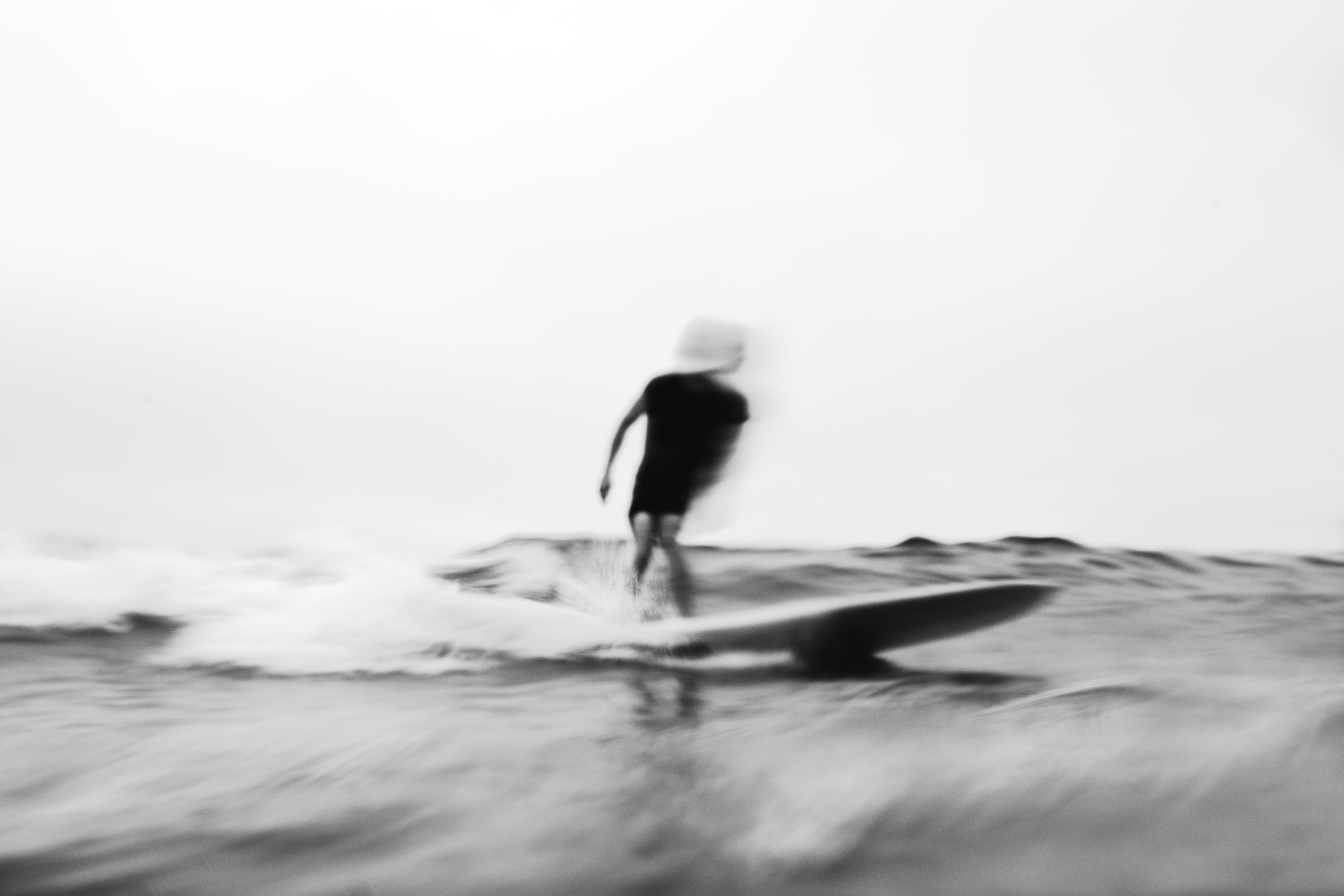 person surfing grayscale photo