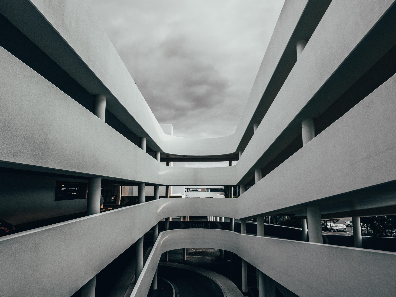gray concrete building under cloudy sky