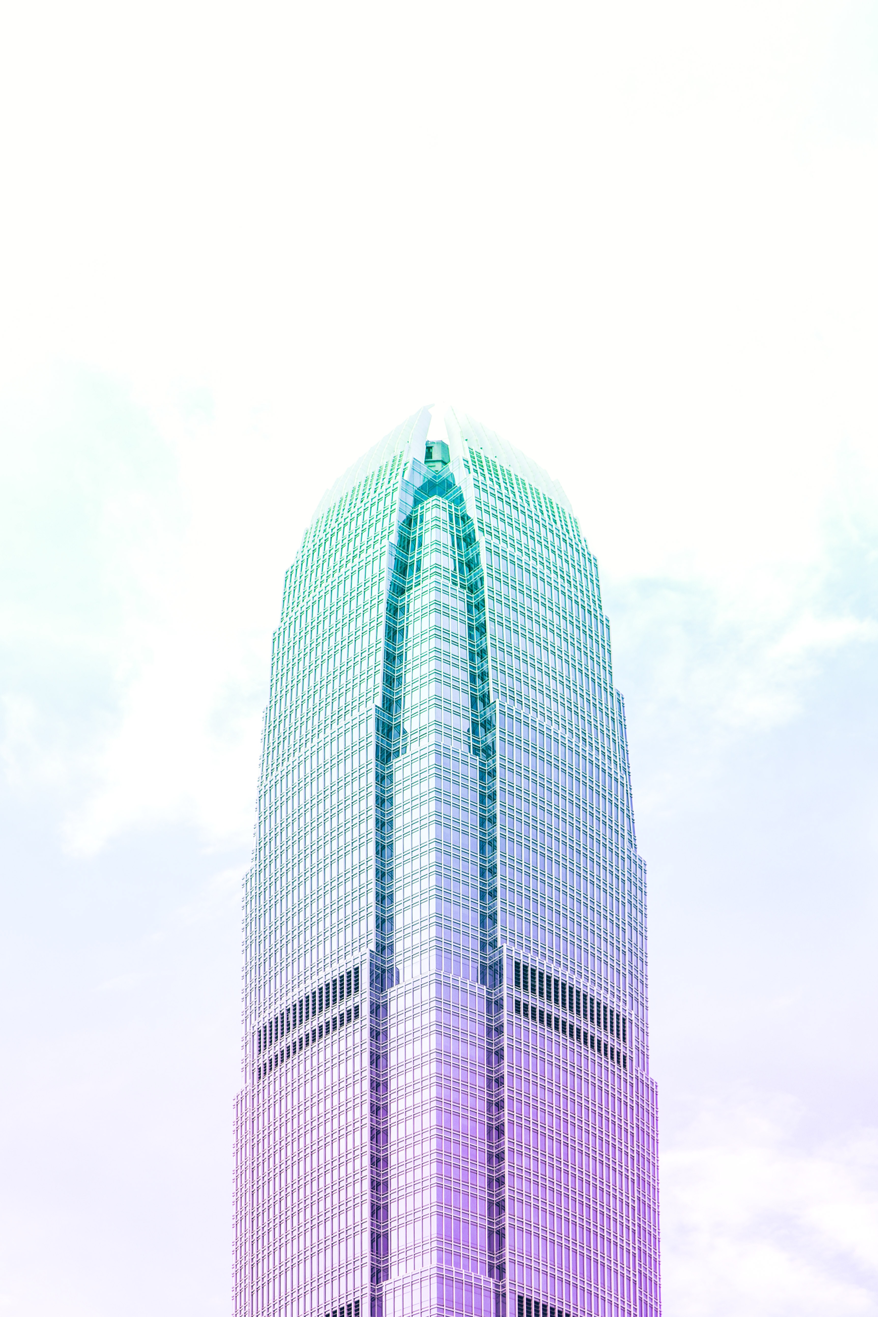 low angle photography of teal and pink highrise building