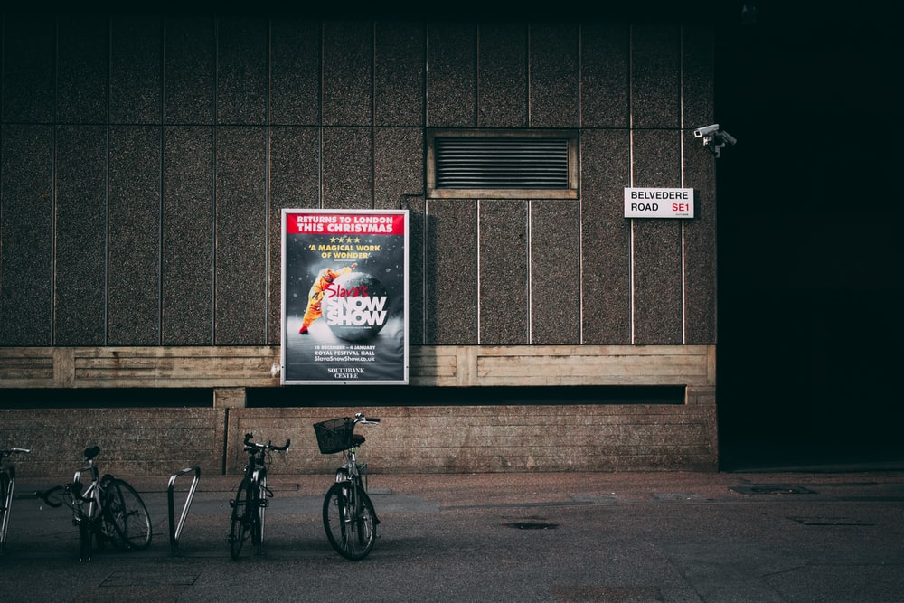 bicycle parked near concrete wall