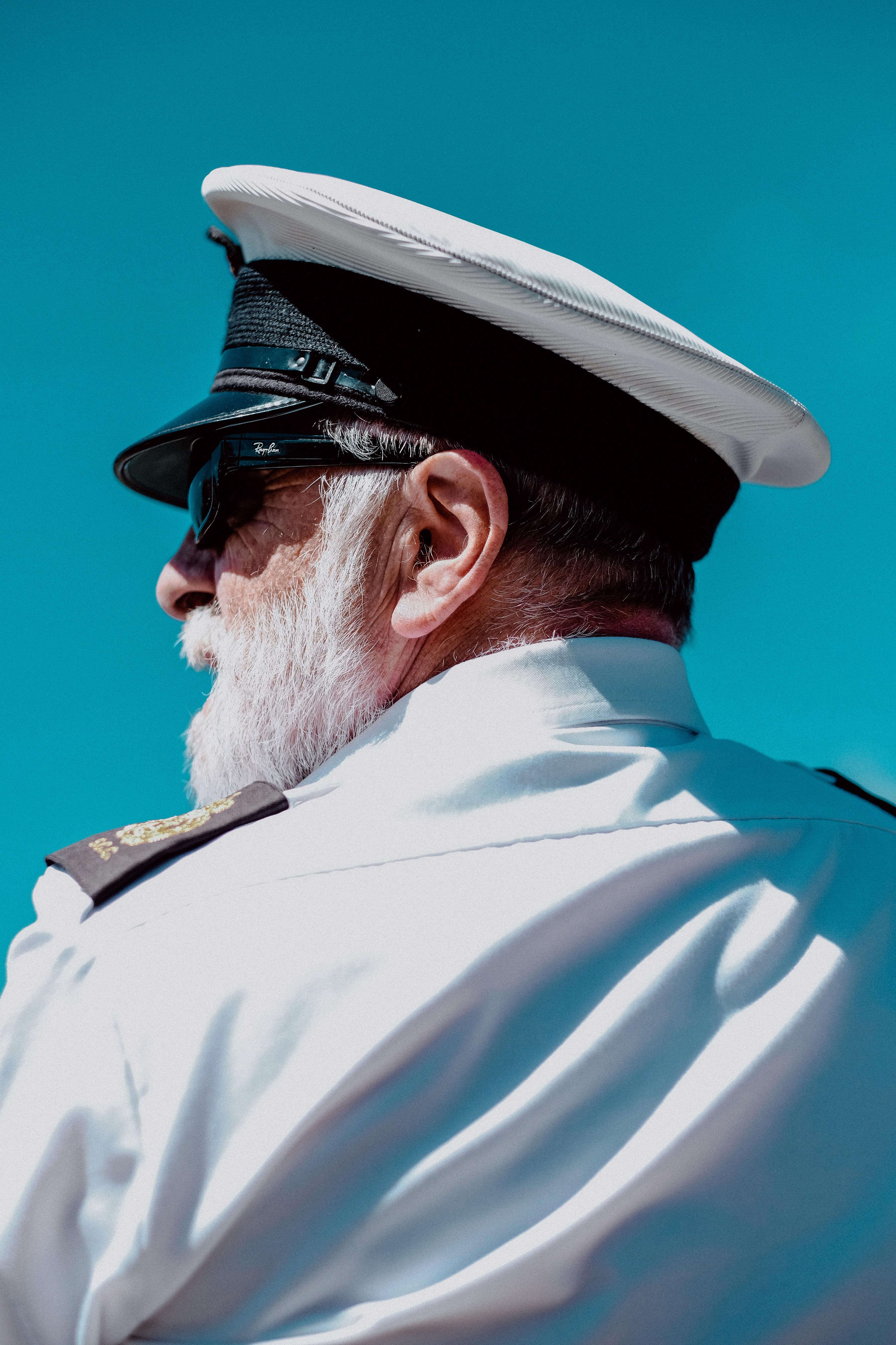 men's white peaked cap
