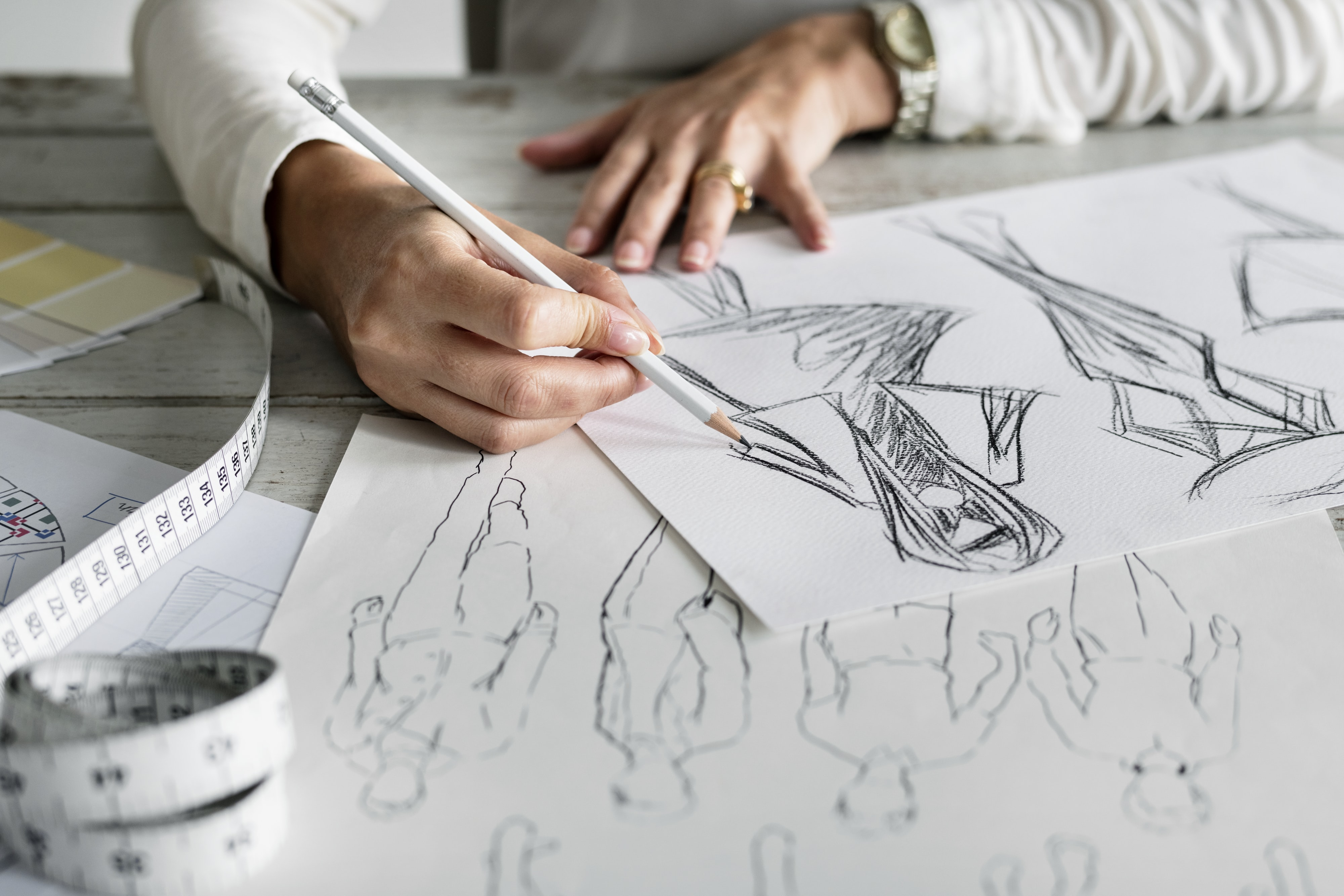 person writing a sketch art