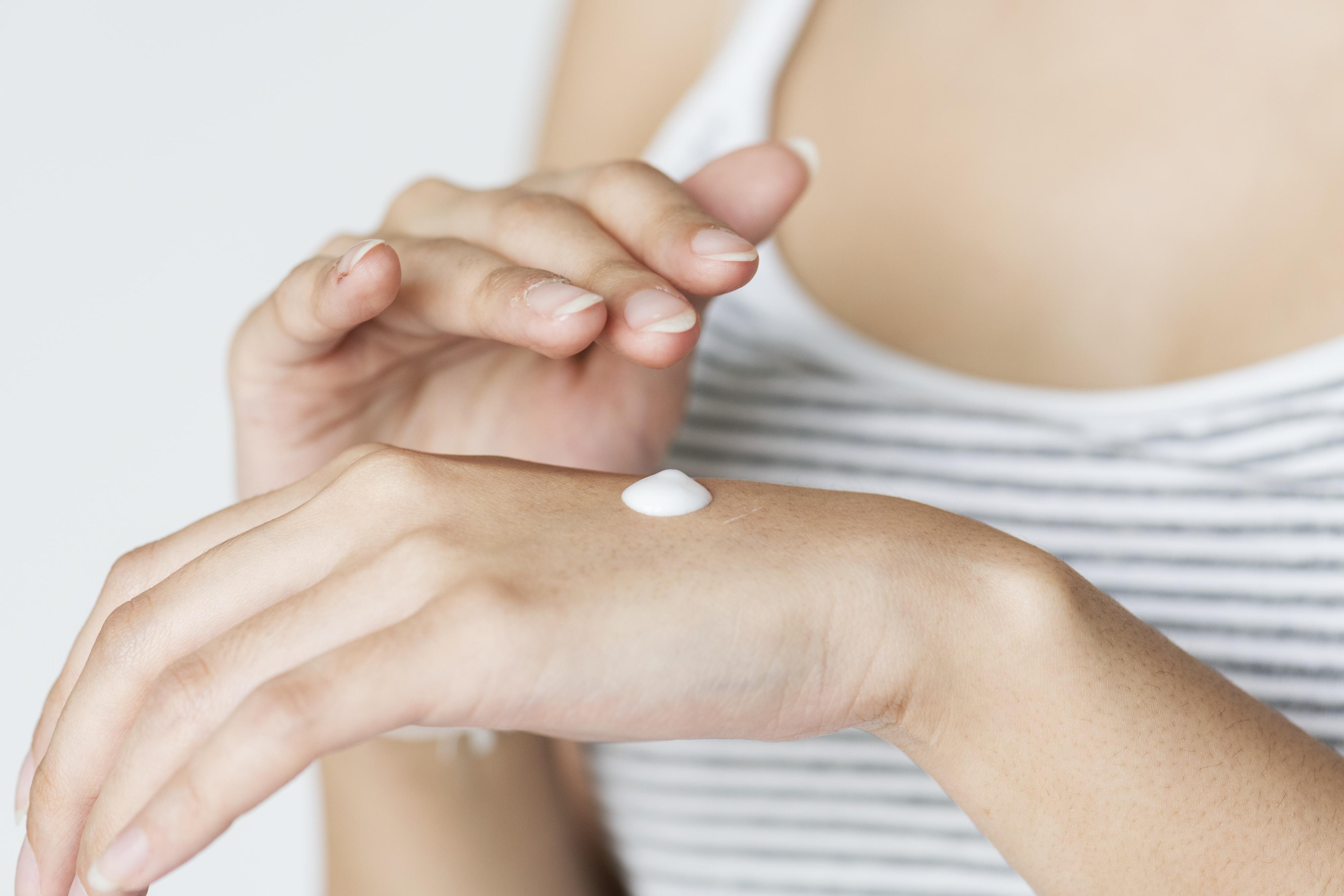 white cream on woman's hand