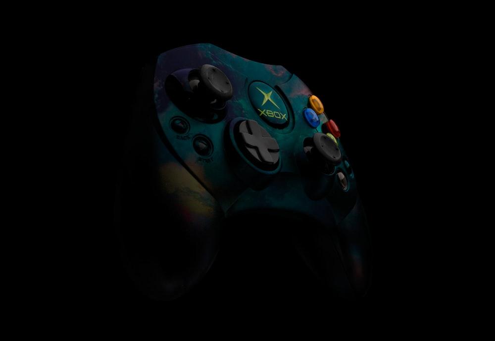 teal and black Xbox Original controller