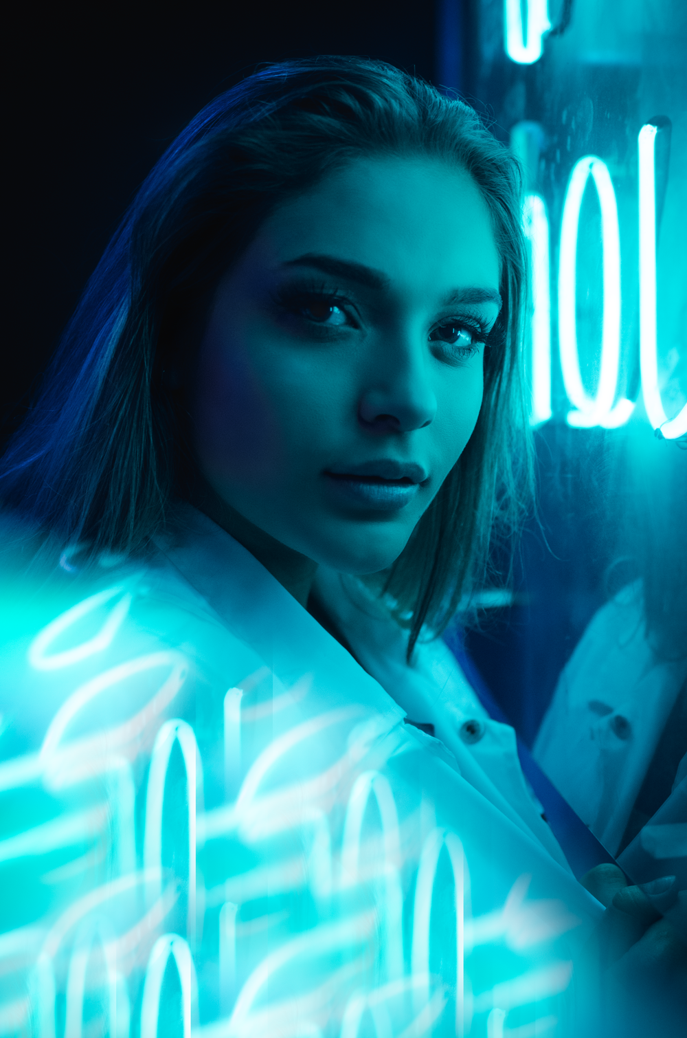 closeup photo of woman near neon light signage