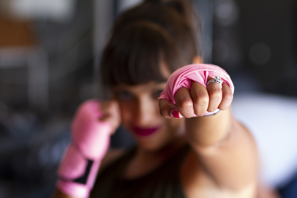 focus photography of woman's fist